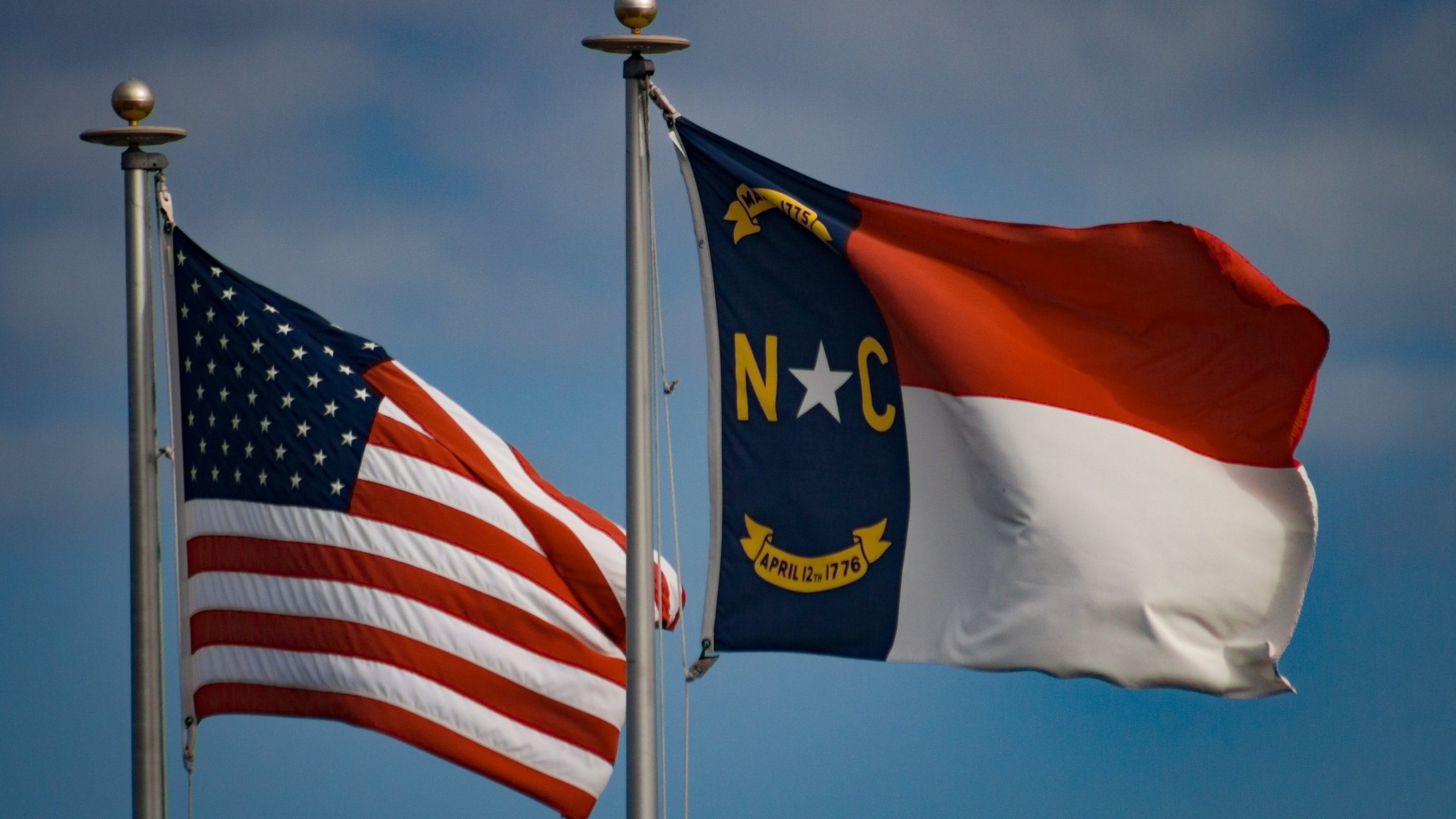 North Carolina and American flags (Darwin Brandis/Getty Images)