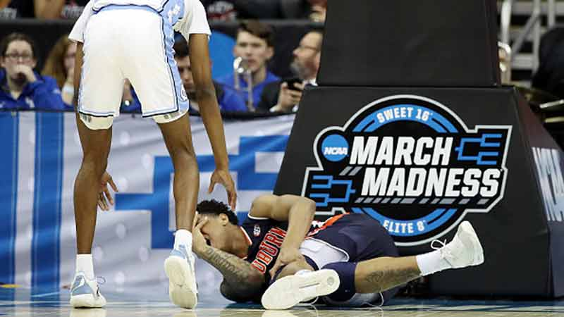 huma Okeke #5 of the Auburn Tigers reacts after suffering an injury against the North Carolina Tar Heels during the 2019 NCAA Basketball Tournament Midwest Regional at Sprint Center on March 29, 2019 in Kansas City, Missouri. (Photo by Christian Petersen/Getty Images)