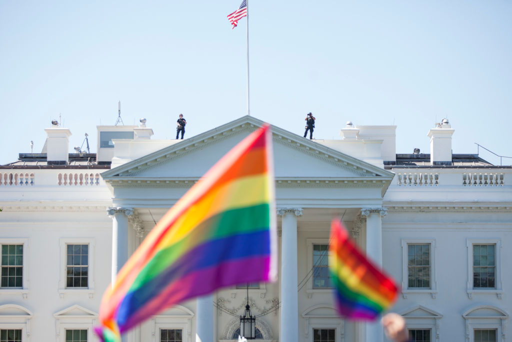 Demonstrators carry rainbow flags past the White House during the Equality March for Unity and Peace on June 11, 2017 in Washington, D.C. (Photo by Zach Gibson/Getty Images)