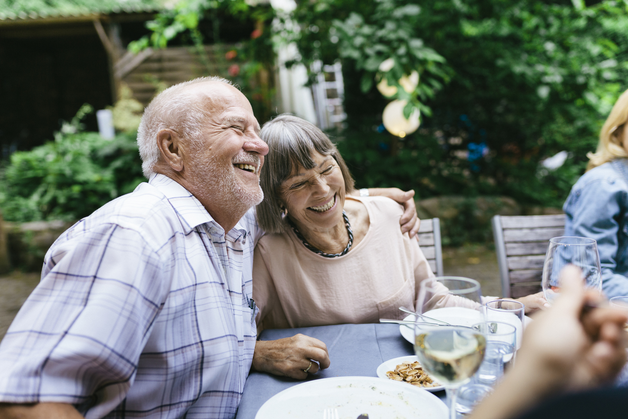 Elderly Couple Enjoying Outdoor Meal With Family (Getty Images)