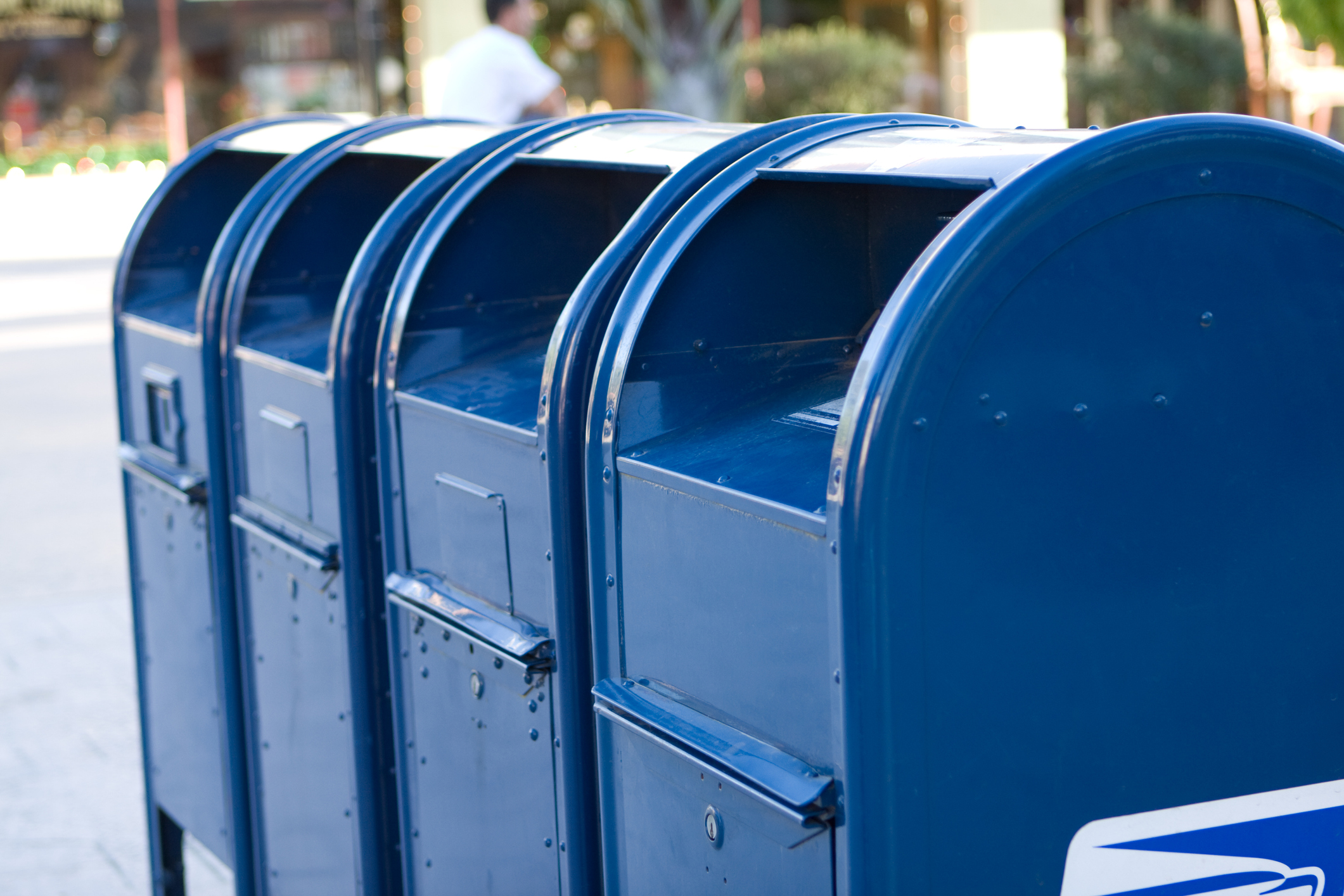 A row of blue mailboxes (Getty Images)