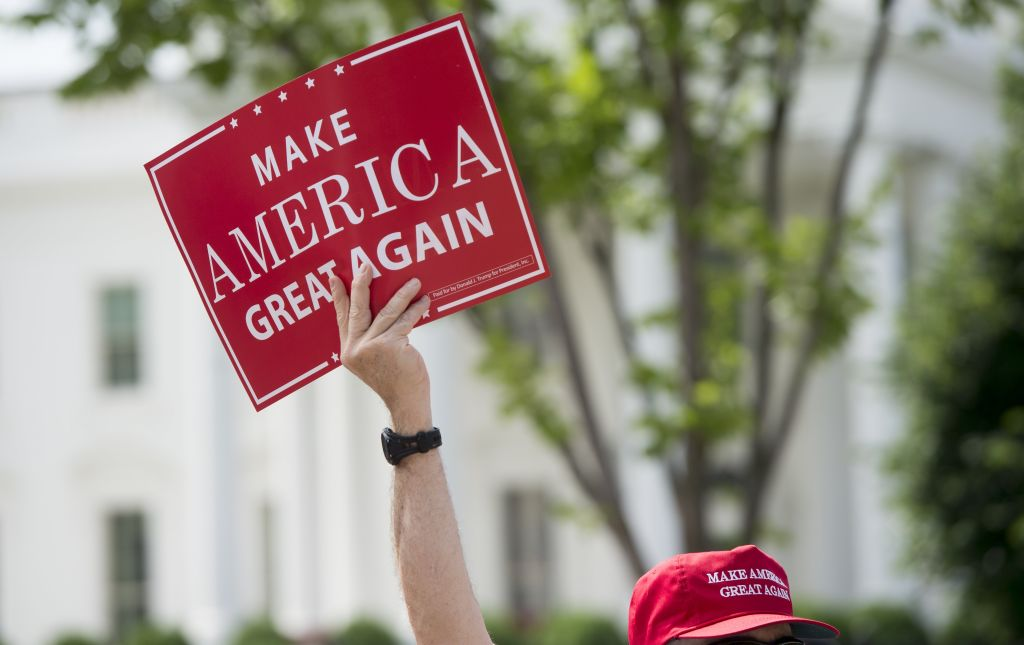"A man holds a Make America Great Again sign as supporters of US President Donald Trump and his policies demonstrate during a ""Pittsburgh Not Paris"" rally in support of his decision to withdraw the US from the Paris Climate Accord during a rally in Lafayette Square next to the White House in Washington, DC, on June 3, 2017. (SAUL LOEB/AFP/Getty Images)"
