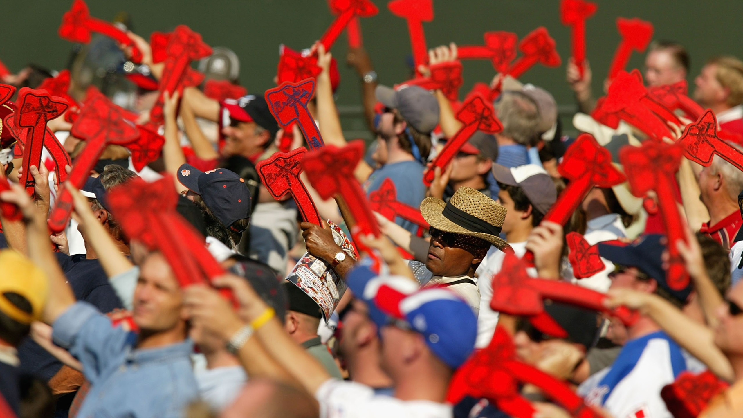 Fans of the Atlanta Braves do the Tomahawk Chop. (Photo by Streeter Lecka/Getty Images)