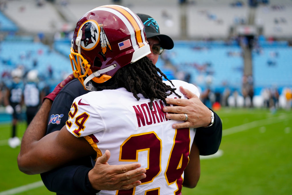 CHARLOTTE, NORTH CAROLINA - DECEMBER 01: Josh Norman #24 of the Washington Redskins embraces head coach Ron Rivera of the Carolina Panthers before their game at Bank of America Stadium on December 01, 2019 in Charlotte, North Carolina. (Photo by Jacob Kupferman/Getty Images)
