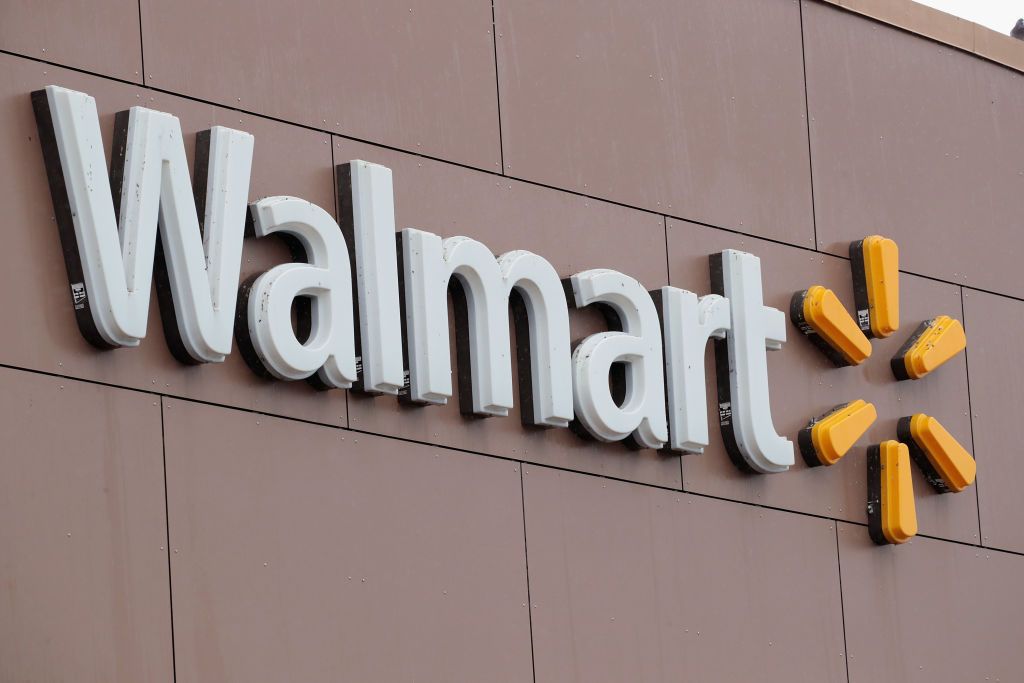 CHICAGO, IL - JANUARY 11: A sign hangs outside Walmart store on January 11, 2018 in Chicago, Illinois. Walmart announced today it would use savings from the recently revised tax law to increase their starting wage to $11-per-hour, offer some hourly employees a one-time bonus up to $1000, expand maternity and parental leave benefits and will begin to offer adoption assistance. The company also disclosed today that it would be closing 63 of its Sam's Club stores across the US, costing thousands of workers their jobs. (Photo by Scott Olson/Getty Images)