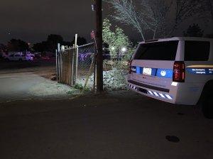 Photo shows a police vehicle near the Phoenix home where three children were found dead. (Phoenix Police Department)