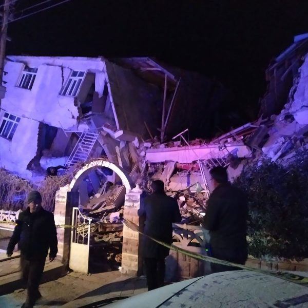 Turkish rescue services and police inspect the scene of a collapsed building following a 6.8 magnitude earthquake in Elazig, eastern Turkey on January 24, 2020, killing several people according to the Turkish interior ministry. - A powerful earthquake with a magnitude of 6.8 hit eastern Turkey, killing at least four people, causing buildings to collapse and sending panicked residents rushing into the street. Rescue teams were being sent to the scene of the quake, which had its epicentre in the small lakeside town of Sivrice in the eastern province of Elazig. (Photo by DHA / DHA / AFP) / Turkey OUT (Photo by DHA/DHA/AFP via Getty Images)