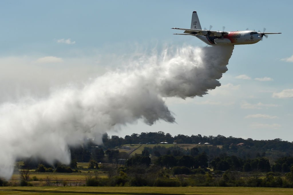 A New South Wales Rural Fire Services Hercules C-130 plane drops water in an exercise at the Royal Australian Airforce base in Richmond on September 1, 2017. (PETER PARKS/AFP via Getty Images)