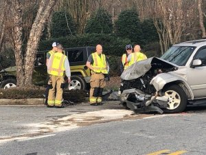 The hood of an SUV is shown smashed after a crash in Guilford County. (Nelson Kepley/WGHP)