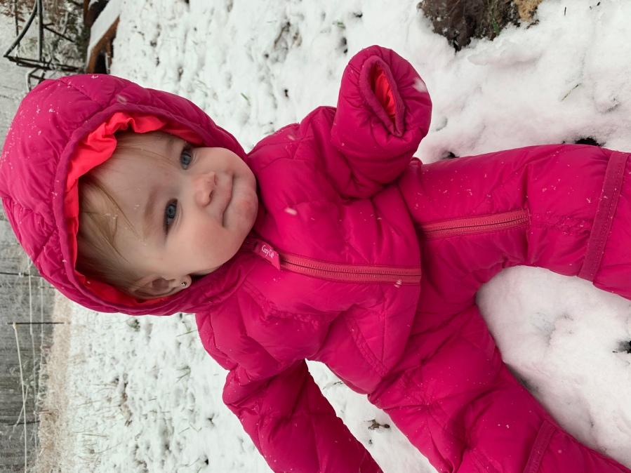 Arabella's fascinated by her first snow!!