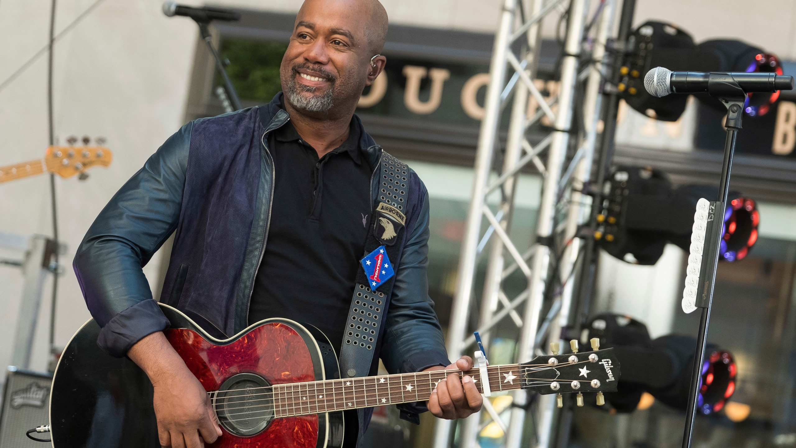 """FILE - In this May 25, 2018 file photo, Darius Rucker performs on NBC's Today show at Rockefeller Plaza in New York. The Country singer couldn't quite believe it when he was surprised this week with the news that his song """"Wagon Wheel"""" was certified eight times platinum, making it one of the top five most popular country singles ever. On Wednesday, Feb. 12, 2020, Rucker stopped by the Country Music Hall of Fame and Museum to his items in an exhibit, but his label, Universal Music Group Nashville, surprised him with a plaque featuring eight platinum-colored records. (Photo by Charles Sykes/Invision/AP, File)"""