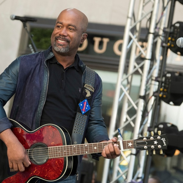 "FILE - In this May 25, 2018 file photo, Darius Rucker performs on NBC's Today show at Rockefeller Plaza in New York. The Country singer couldn't quite believe it when he was surprised this week with the news that his song ""Wagon Wheel"" was certified eight times platinum, making it one of the top five most popular country singles ever. On Wednesday, Feb. 12, 2020, Rucker stopped by the Country Music Hall of Fame and Museum to his items in an exhibit, but his label, Universal Music Group Nashville, surprised him with a plaque featuring eight platinum-colored records. (Photo by Charles Sykes/Invision/AP, File)"