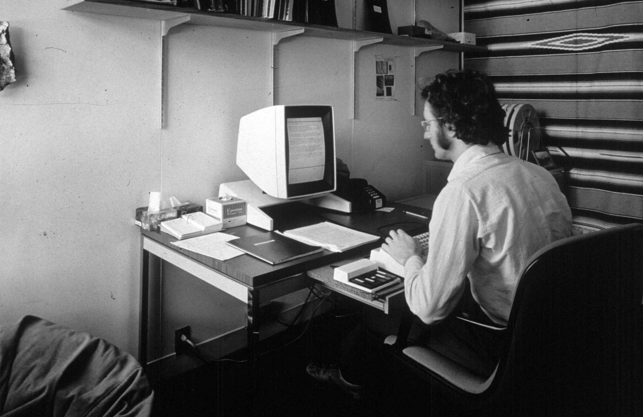 "In this 1970s photo provided by Xerox PARC, Larry Tesler uses the Xerox Parc Alto early personal computer system. Tesler, the Silicon Valley pioneer who created the now-ubiquitous computer concepts such as ""cut,"" ""copy"" and ""paste,"" has died. He was 74. (Xerox PARC via AP)"