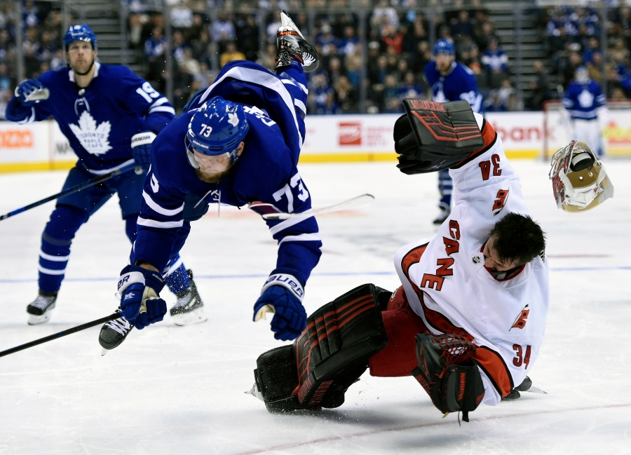 Carolina Hurricanes goaltender Petr Mrazek (34) hits the ice after Toronto Maple Leafs left wing Kyle Clifford (73) skated into him during second-period NHL hockey game action in Toronto, Saturday, Feb. 22, 2020. (Frank Gunn/The Canadian Press via AP)