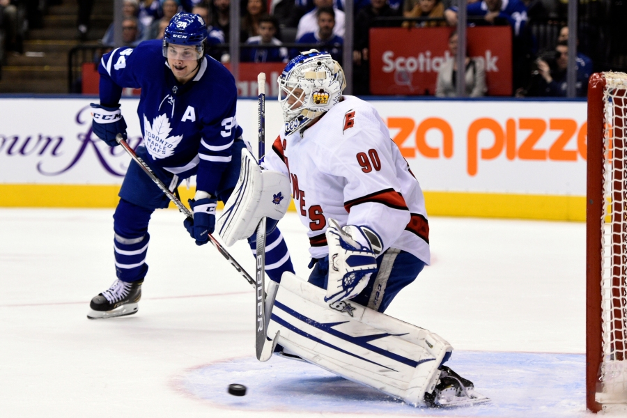 Toronto Maple Leafs center John Tavares (not shown) scores his team's second goal of an NHL hockey game against Carolina Hurricanes emergency goalie David Ayres (90) during second-period NHL hockey game action in Toronto, Saturday, Feb. 22, 2020. (Frank Gunn/The Canadian Press via AP)