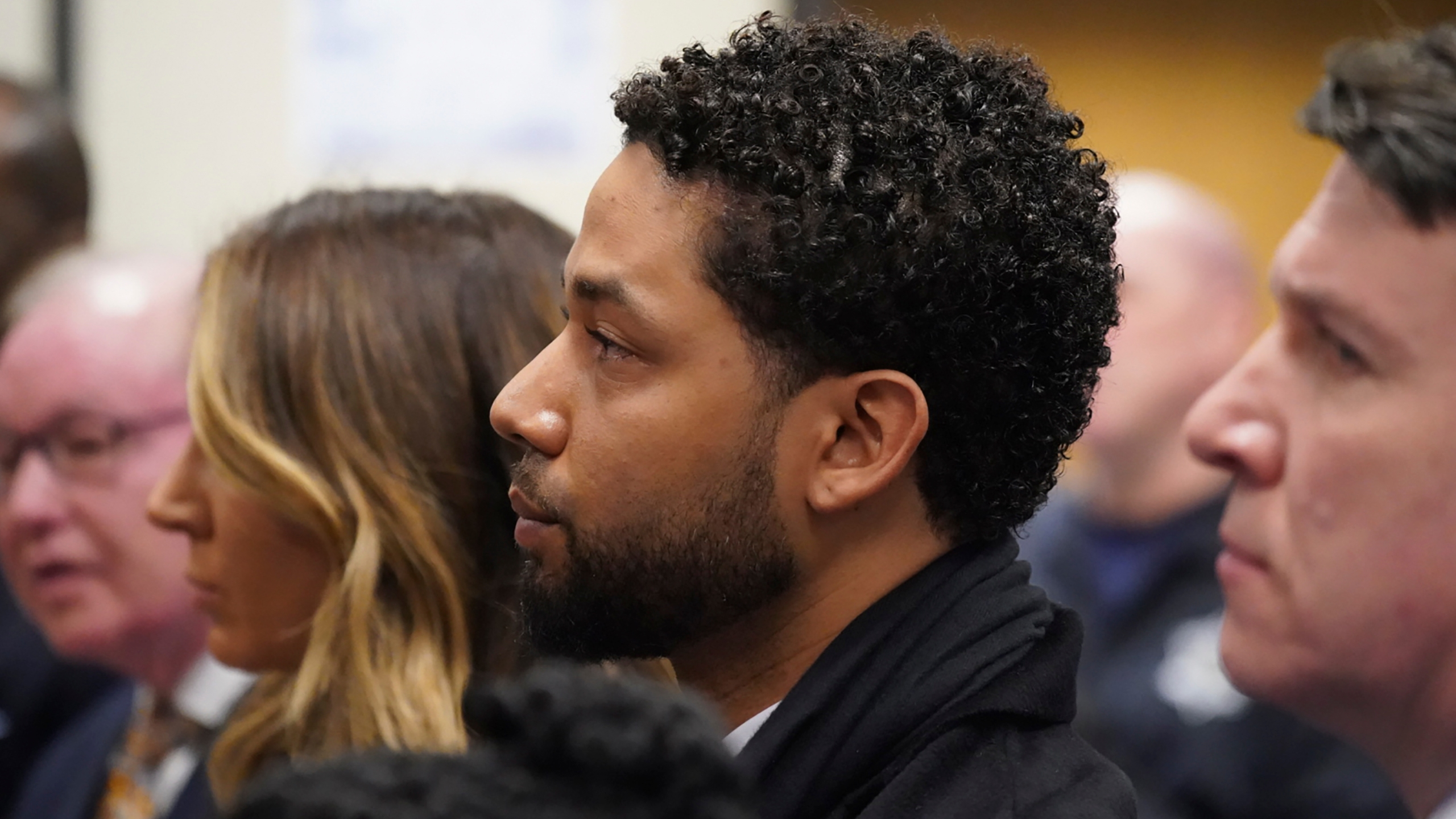 Actor Jussie Smollett, center, appears in a courtroom at the Leighton Criminal Court Building in Chicago on Feb. 24, 2020, where he plead not guilty to restored charges that accuse him of staging a racist, homophobic attack against himself and falsely reporting it to police. He faces six counts of felony disorderly conduct. (Brian Cassella/Chicago Tribune via AP, Pool)