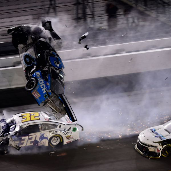 DAYTONA BEACH, FLORIDA - FEBRUARY 17: Denny Hamlin, driver of the #11 FedEx Express Toyota, wins over Ryan Blaney, driver of the #12 Menards/Peak Ford, as Ryan Newman, driver of the #6 Koch Industries Ford, crashes and flips behind them during the NASCAR Cup Series 62nd Annual Daytona 500 at Daytona International Speedway on February 17, 2020 in Daytona Beach, Florida. (Photo by Jared C. Tilton/Getty Images)