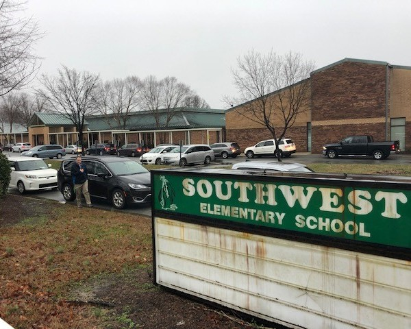Parents lining up to pick up their students in front of Southwest Elementary School
