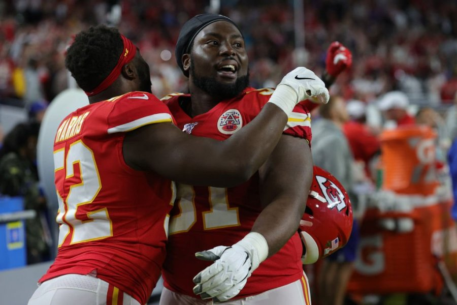 Derrick Nnadi #91 of the Kansas City Chiefs celebrates with Demone Harris #52 after they defeated the San Francisco 49ers 31-20 in Super Bowl LIV at Hard Rock Stadium on February 02, 2020 in Miami, Florida. (Photo by Jamie Squire/Getty Images)