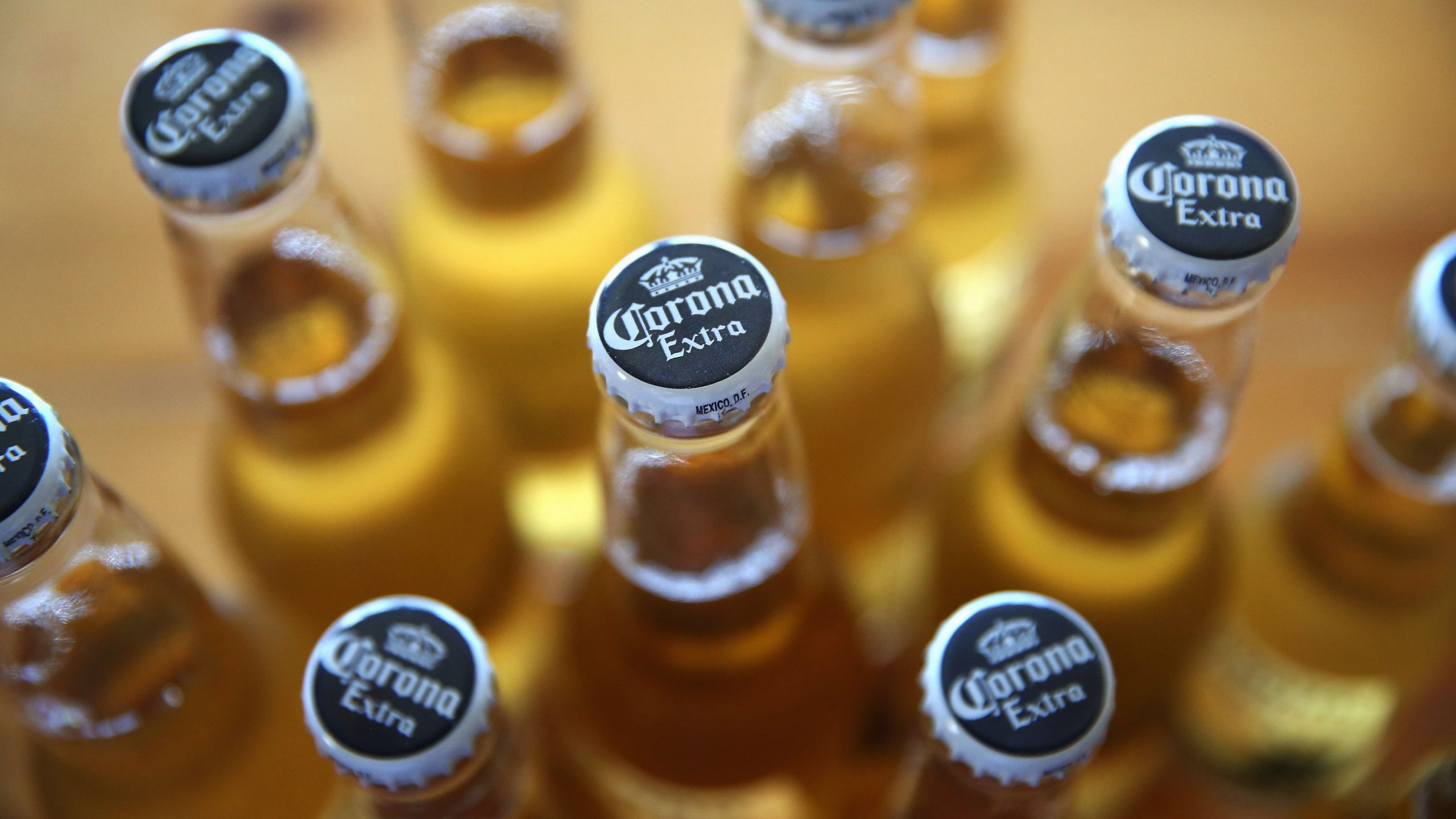 In this photo illustration, bottles of Corona beer are shown on June 7, 2013 in Chicago, Illinois. Constellation Brands, one of the world's largest wine companies, is expected to become the third-largest beer supplier in the United State today with a $5.3 billion purchase of the U.S. distribution rights of Grupo Modelo beers from Anheuser Busch InBev. Corona Extra, brewed by Grupo Modelo, is the number one selling imported beer sold in the United States and the number six selling beer overall. (Photo Illustration by Scott Olson/Getty Images)