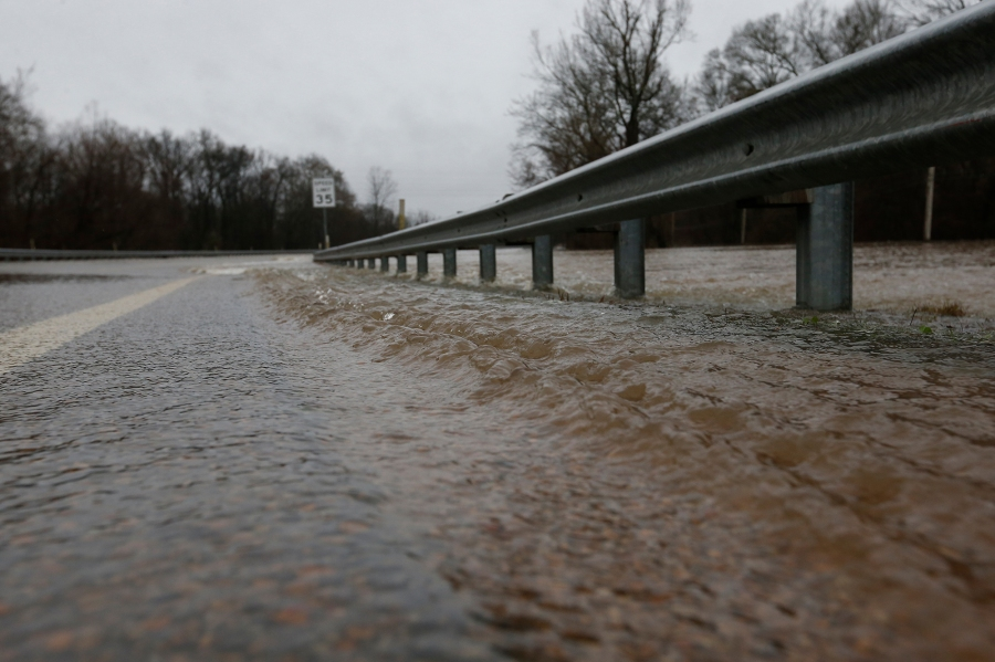 Strong currents from the swollen Pearl River push under the guardrail along the Old Brandon Road Bridge in Jackson, Miss., Sunday, Feb. 16, 2020. Authorities predict the river to crest at 38 feet. Only twice before has the Pearl River surpassed 38 feet — during the historic floods of 1979 and 1983. (AP Photo/Rogelio V. Solis)