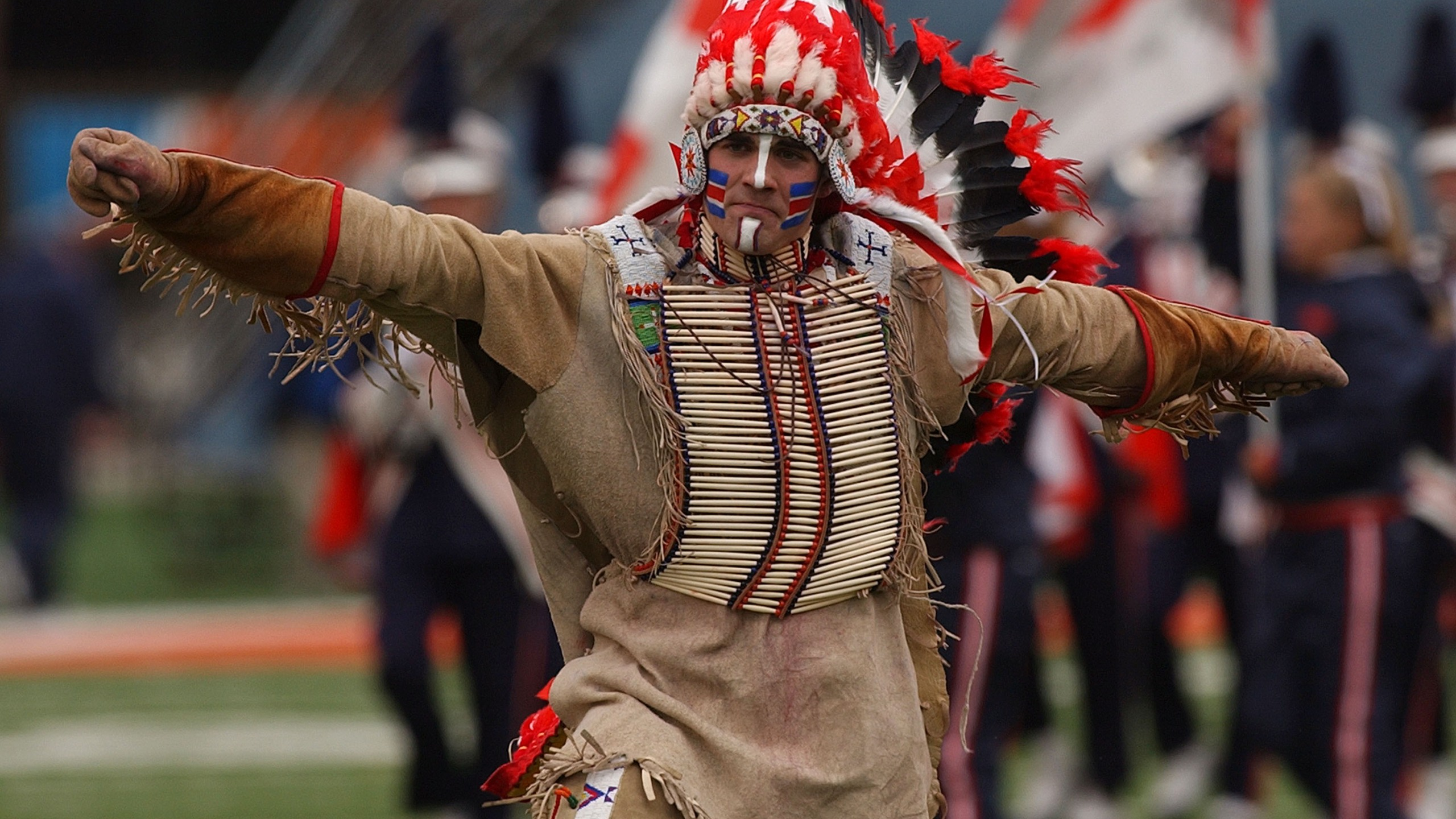 "Controversial symbol ""Chief Illiniwek"" of the University of Illinois performs during the half-time show of a game between Illinois and Michigan at Memorial Stadium October 16, 2004 in Champaign, Illinois. (Photo by Jonathan Daniel/Getty Images)"