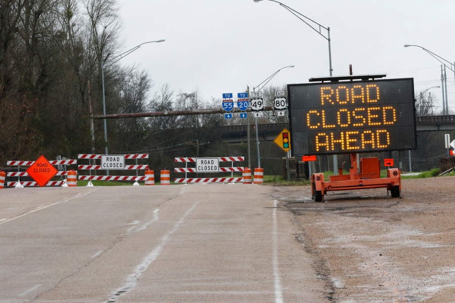 Authorities have blocked off a number of roads in Jackson, Miss., due to the flooding from the Pearl River. Authorities in Mississippi were bracing Sunday for the possibility of catastrophic flooding in and around the state capital of Jackson as water levels rise precipitously in a river swollen by days of torrential rain. (AP Photo/Rogelio V. Solis)
