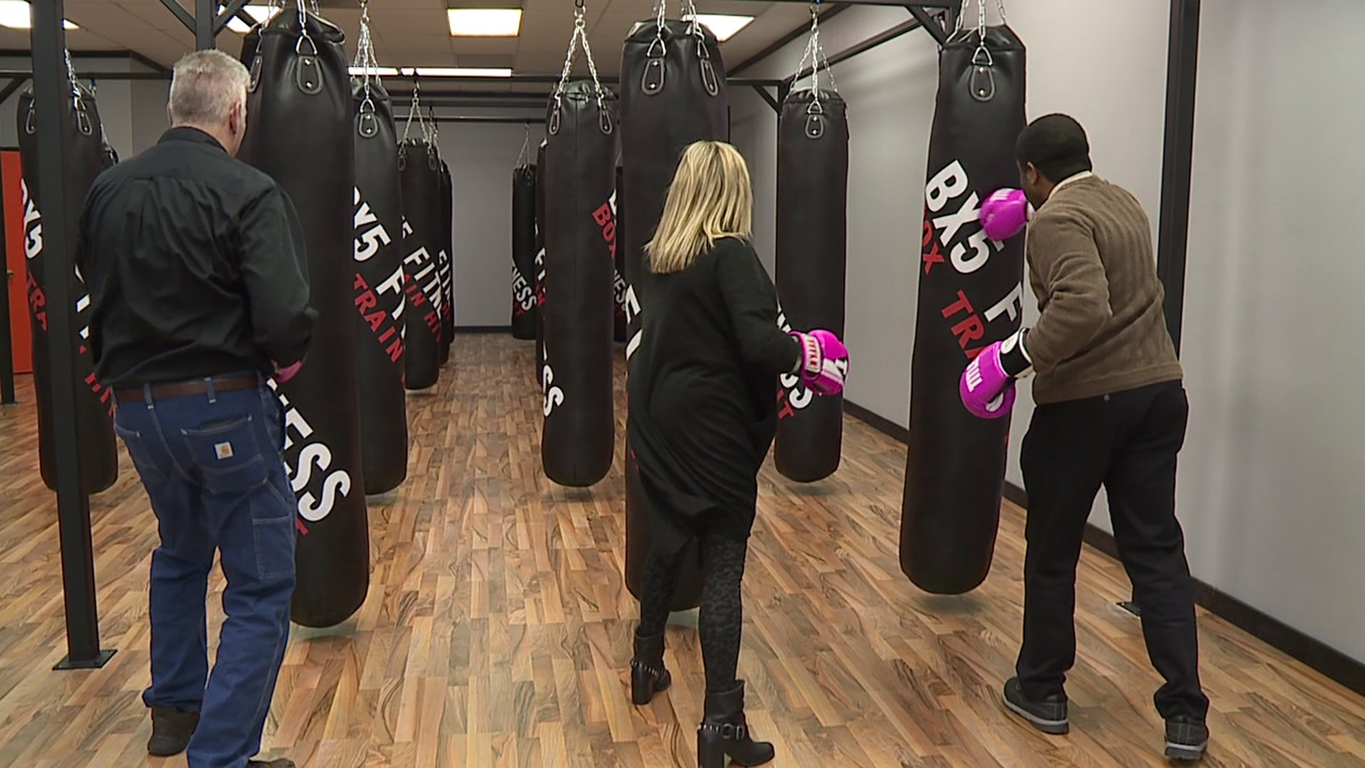 Community members in Alamance County raising money for breast cancer patients with boxing fundraiser