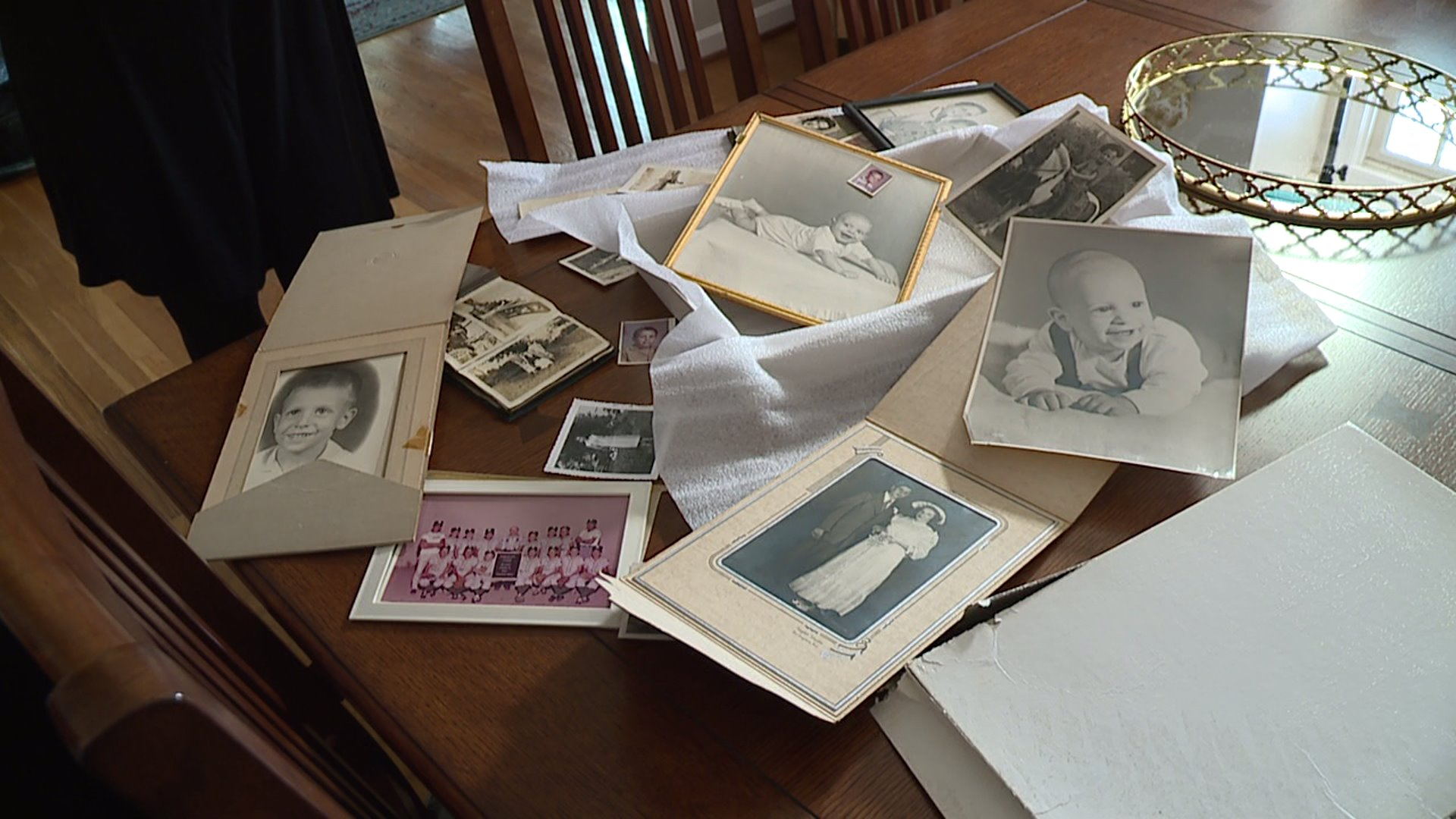 Woman finds old family photos on side of road in Greensboro