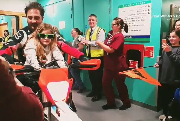 Motocross racers ride through hospital halls to cheer up children