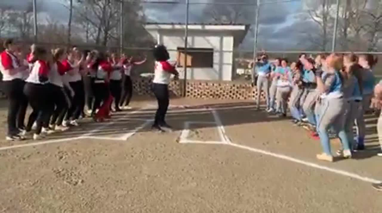 Trinity High School and Page High School softball teams were ready to face off Tuesday, but the game ended up starting late. To pass the team, the Bulldogs and Pirates decided to dance together.