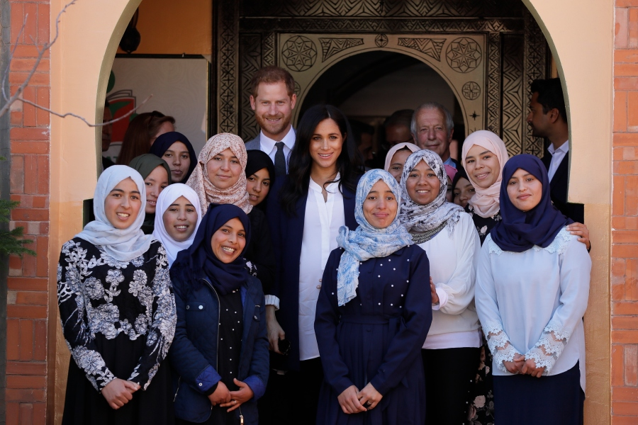 FILE - In this Sunday, Feb. 24, 2019 file photo, Britain's Prince Harry and Meghan, Duchess of Sussex pose for a photo during an Investiture for Michael McHugo the founder of 'Education for All' with the Most Excellent Order of the British Empire, in Asni Town in Morocco. Prince Harry and his wife, Meghan, are fulfilling their last royal commitment Monday March 9, 2020 when they appear at the annual Commonwealth Service at Westminster Abbey. It is the last time they will be seen at work with the entire Windsor clan before they fly off into self-imposed exile in North America. (AP Photo/Kirsty Wigglesworth, file)