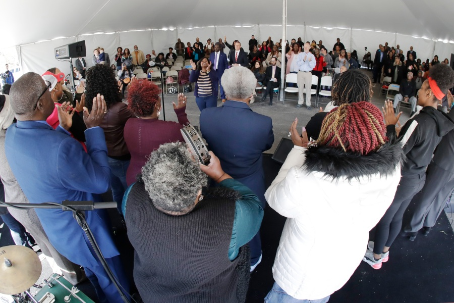 A choir performs during a worship service in a tent at Mount Bethel Missionary Baptist Church, Sunday, March 8, 2020, in Nashville, Tenn. The congregation held their Sunday service in a tent in the parking lot near the church facilities, which were heavily damaged by a tornado March 3. (AP Photo/Mark Humphrey)