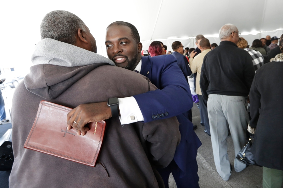 Pastor Jacques Boyd hugs worshipper Gene Hancock, left, after service at Mount Bethel Missionary Baptist Church, Sunday, March 8, 2020, in Nashville, Tenn. The congregation held their Sunday service in a tent in the parking lot near the church facilities, which were heavily damaged by a tornado March 3. (AP Photo/Mark Humphrey)
