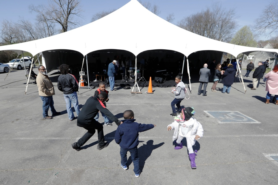 Children play after a worship service under a tent at Mount Bethel Missionary Baptist Church, Sunday, March 8, 2020, in Nashville, Tenn. The congregation held their Sunday service under the tent near the church facilities, which were heavily damaged by a tornado March 3. (AP Photo/Mark Humphrey)
