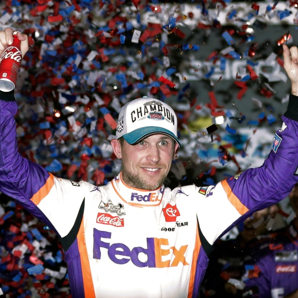 Denny Hamlin celebrates in Victory Lane after winning the NASCAR Daytona 500 auto race at Daytona International Speedway in Daytona Beach, Fla. NASCAR eased off the brake in the real sports world brought to a sudden halt by the coronavirus and introduced the country to iRacing with some of the sports biggest stars. Hamlin, the three-time Daytona 500 winner, beat Dale Earnhardt Jr. off the final corner Sunday, March 22, 2020 at virtual Homestead-Miami Speedway to win the bizarre spectacle. (AP Photo/John Raoux, File)