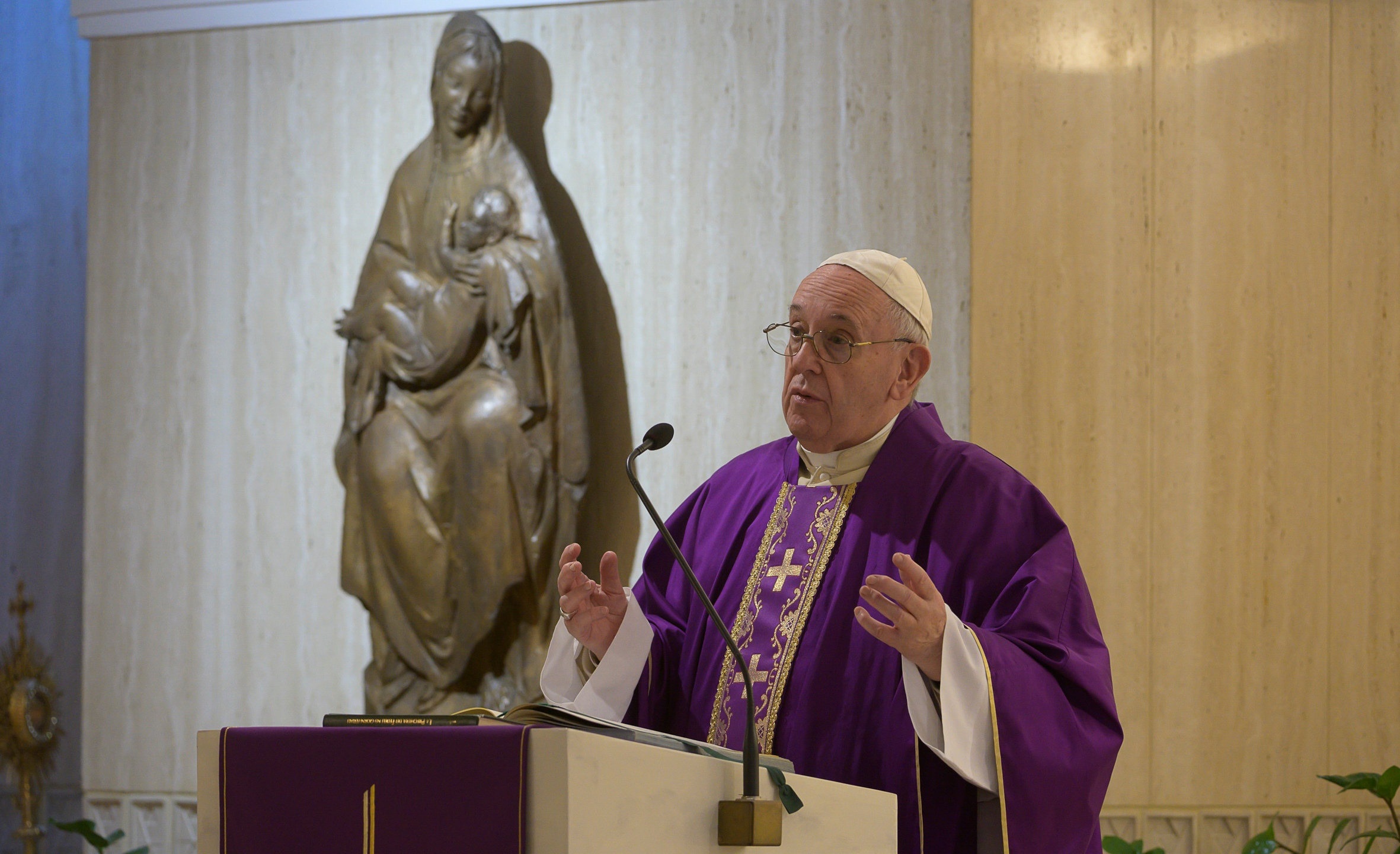 Pope Francis celebrates Mass at his Santa Marta residence, at the Vatican, Friday, March 27, 2020. The new coronavirus causes mild or moderate symptoms for most people, but for some, especially older adults and people with existing health problems, it can cause more severe illness or death. (Vatican News via AP)