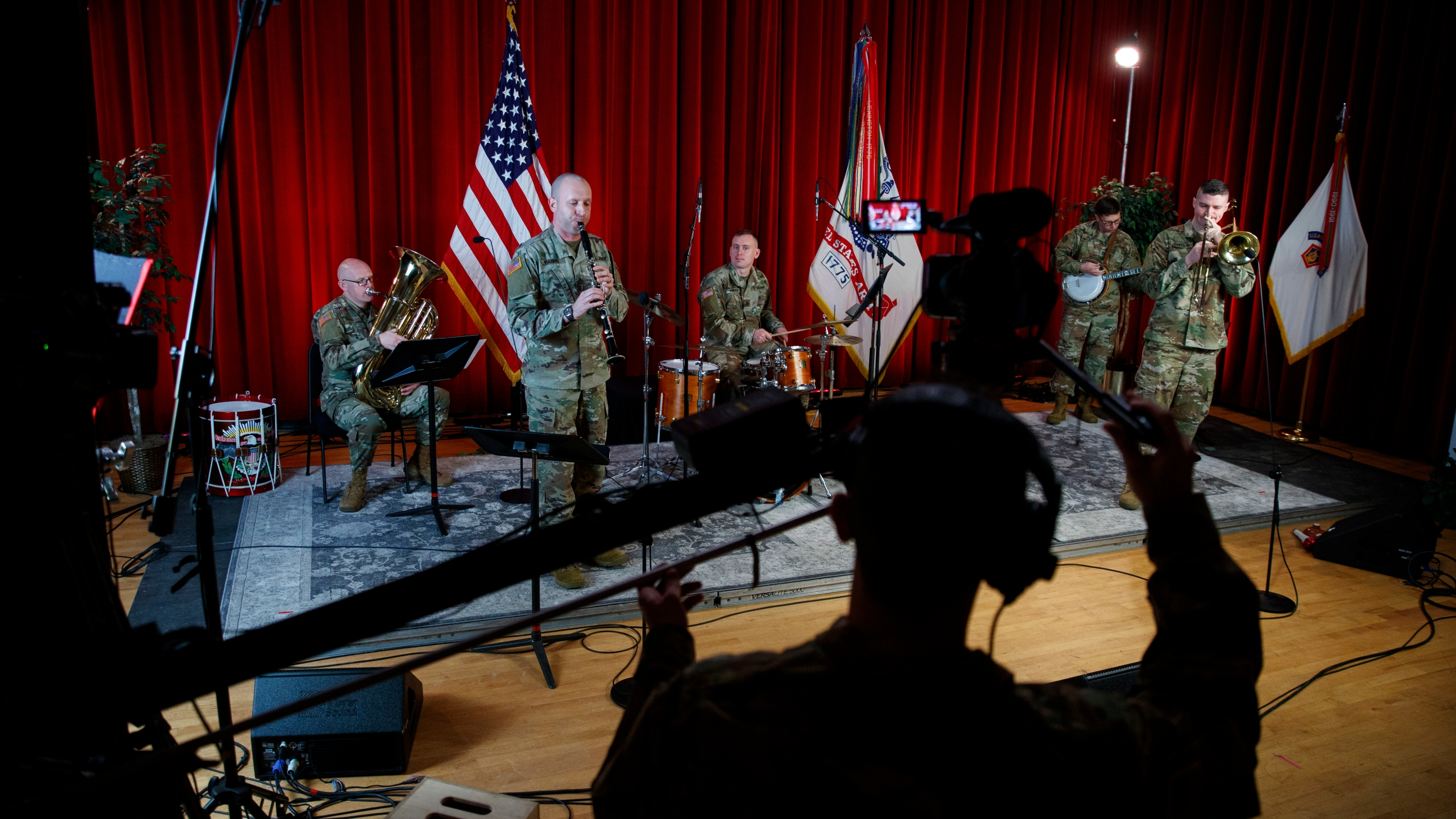 "U.S. Army Field Band members from left, Chief Warrant Officer 2 Kevin Pick, on the tuba, Master Sgt. Bradford Danho, on the clarinet, Staff Sgt. Andrew Emerich, on the drums, Sgt. 1st Class Jonathan Epley, on the banjo and Staff Sgt. Kyle Johnson, on the trombone, are spaced to allow for social distancing as they play during the rehearsal of their daily ""We Stand Ready"" virtual concert series at Fort George G. Meade in Fort Meade, Md., Wednesday, March 25, 2020. The Army Field Band's mission is to bring the military's story to the American people. And they're not letting the coronavirus get in the way. (AP Photo/Carolyn Kaster)"