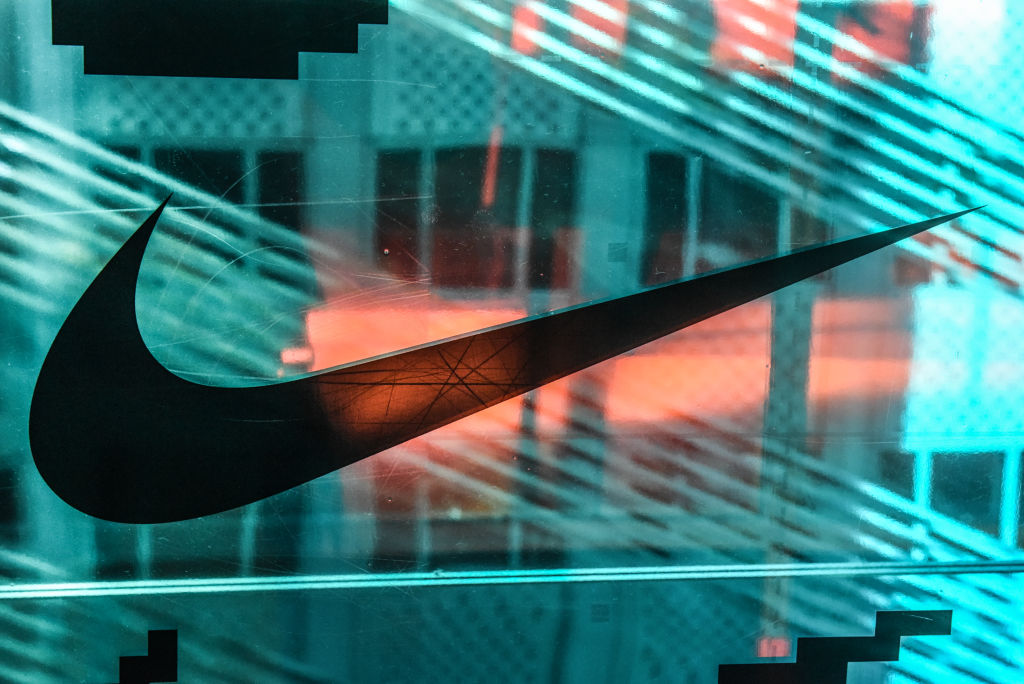 A Nike logo is seen at the Nike flagship store on 5th Ave. on December 20, 2019 in New York City. Revenue in the North American market, which accounts for the majority of Nikes sales, rose 5% from a year ago. The company said its Jordan brand had its first ever billion-dollar quarter. (Photo by Stephanie Keith/Getty Images)
