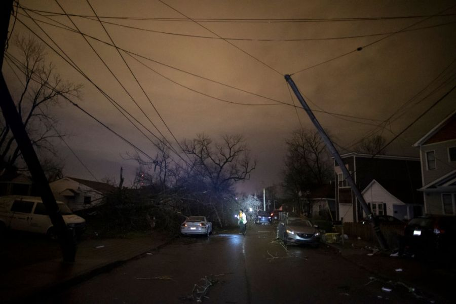 NASHVILLE, TN - MARCH 03:  A resident makes her way down Underwood St. amidst downed trees and heavy debris on March 3, 2020 in Nashville, Tennessee. (Photo by Brett Carlsen/Getty Images)