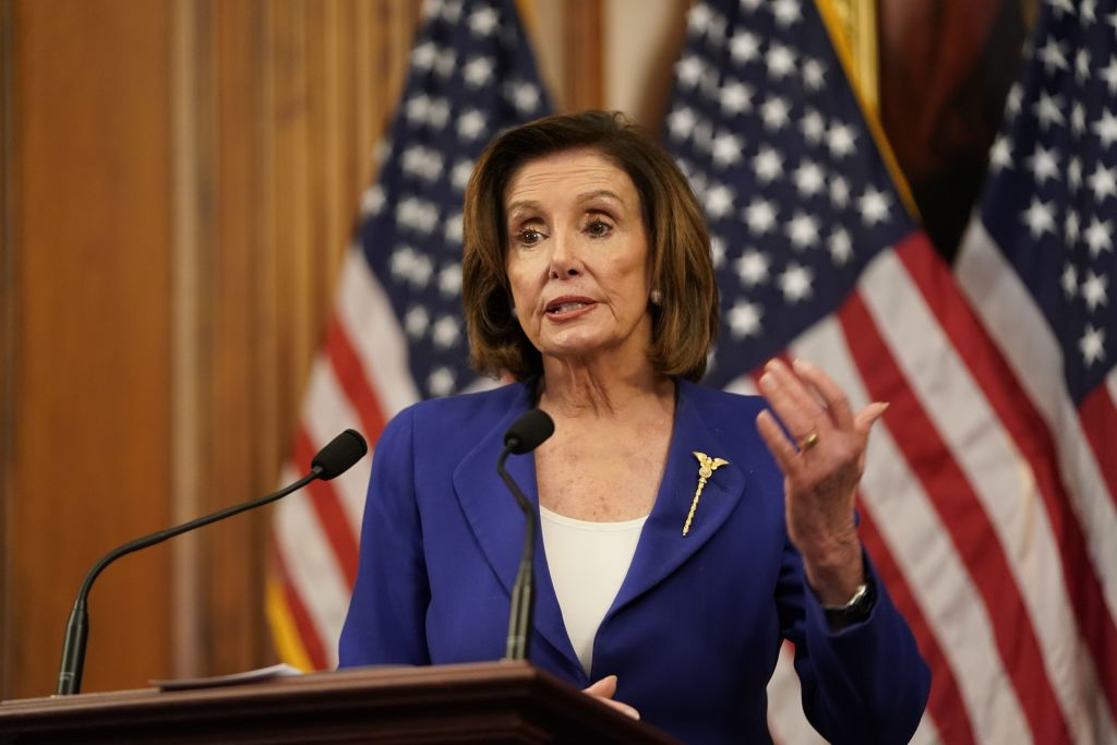 US Speaker of the House Nancy Pelosi speaks to the press after the House passed a $2 trillion stimulus bill, on March 27, 2020, at the US Capitol in Washington, DC. - The House approved by a voice vote a $2.2 trillion rescue package, the largest economic stimulus package in American history, to aid a US economy and health care system battered by the coronavirus pandemic. (Photo by ALEX EDELMAN / AFP) (Photo by ALEX EDELMAN/AFP via Getty Images)