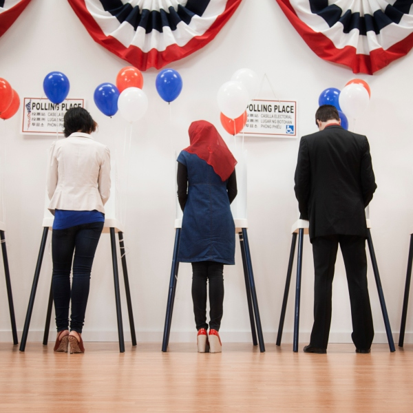 Voters voting in polling place. (Getty Images)