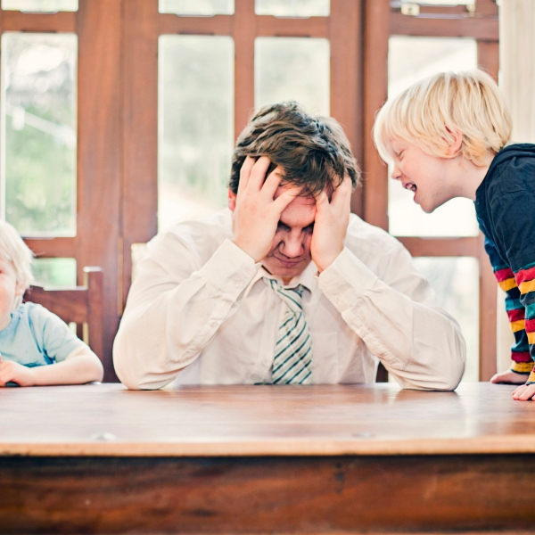 Stock image of a dad and two kids. (Getty Images)