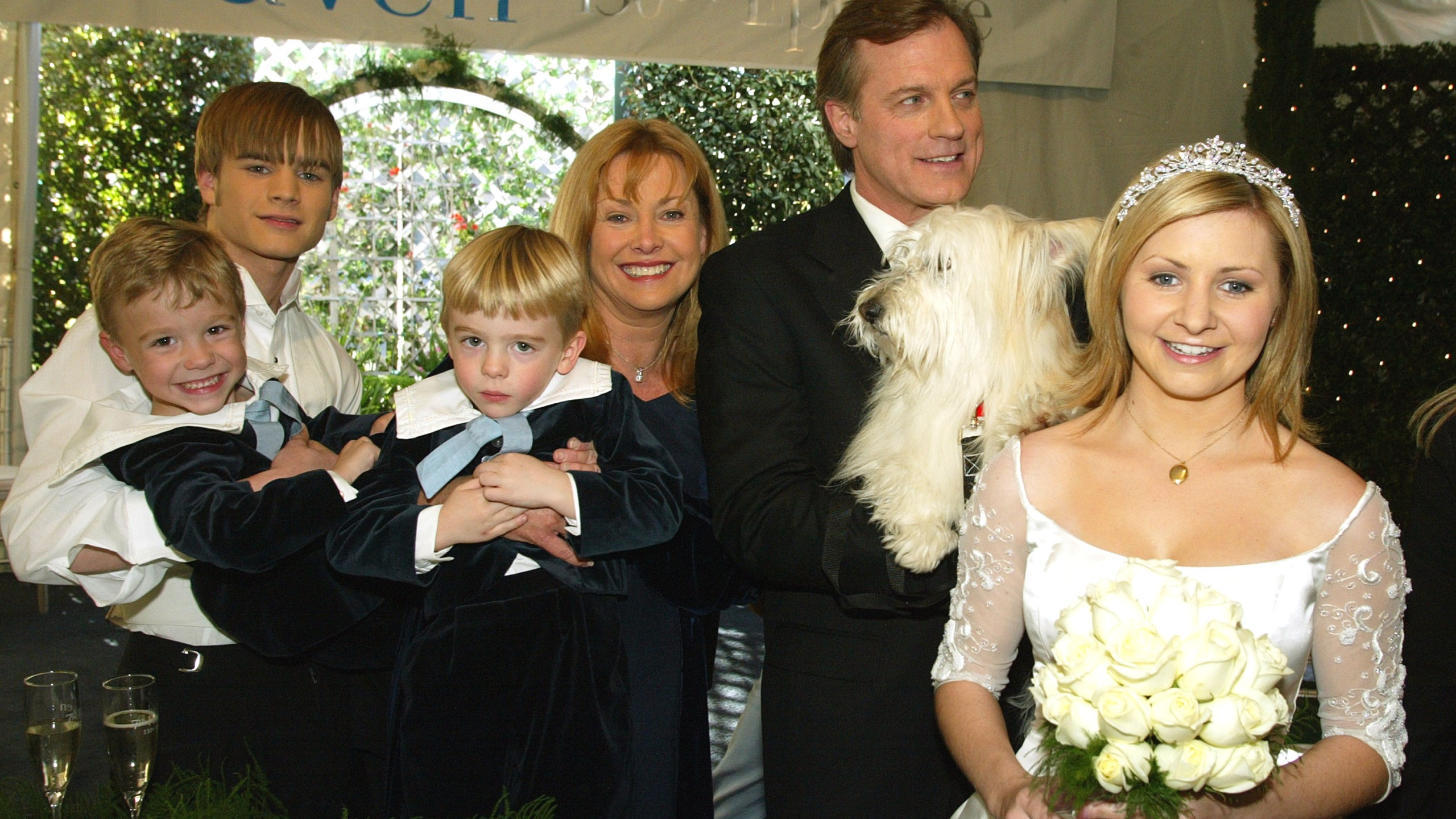 "Actors (L to R) David Gallagher, twins Lorenzo and Nikolas Brino, Catherine Hicks, Stephen Collins and Beverley Mitchell pose at a reception to celebrate 150 episodes of The WB's ""7th Heaven"" on February 20, 2003 in Los Angeles, California. (Photo by Kevin Winter/Getty Images)"