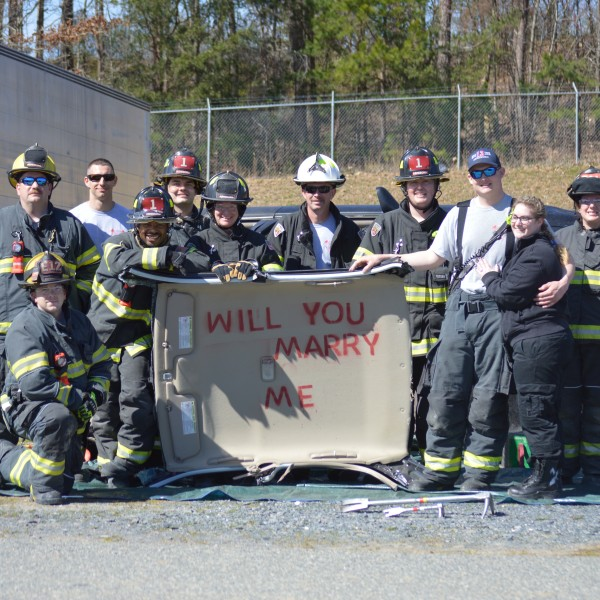 Asheboro firefighter proposes to paramedic girlfriend with overturned car. (Submitted photo)