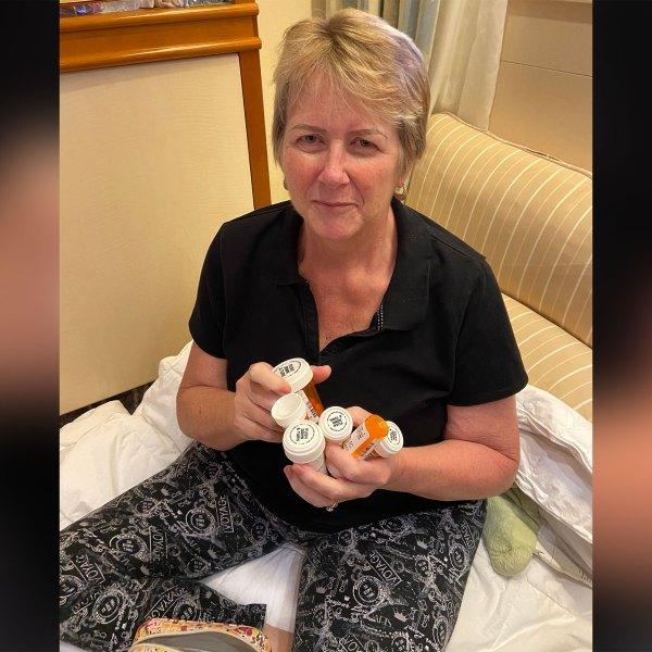 Kari Kolstoe shows the medications she takes for her cancer.