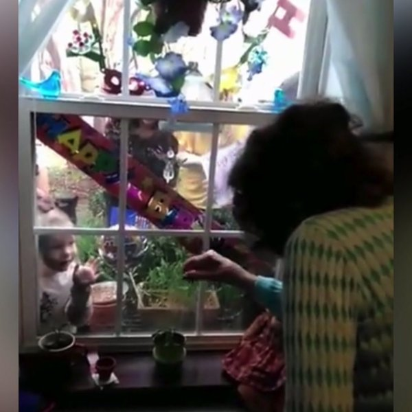 Local families connect with loved ones through windows amid coronavirus outbreak
