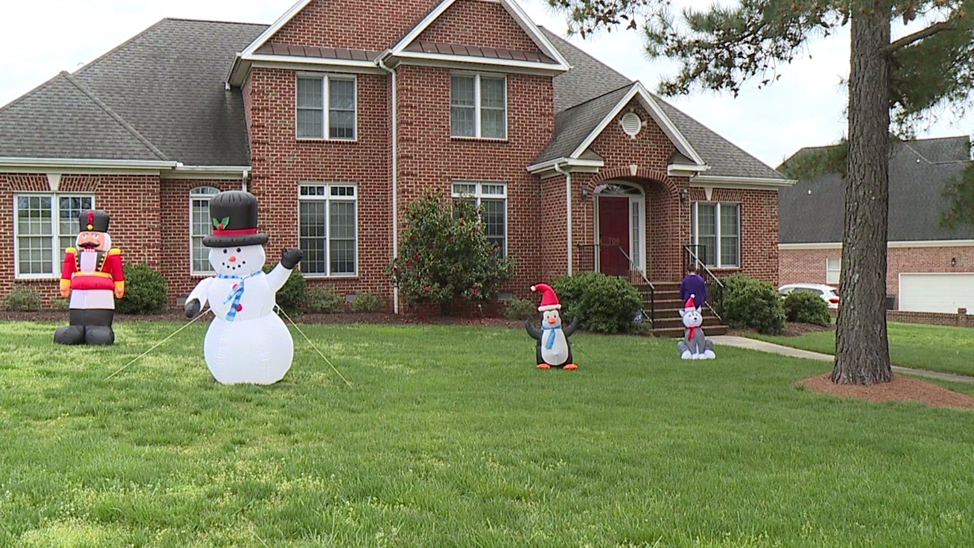 Burlington neighbors put up Christmas decorations to spread cheer amid coronavirus outbreak