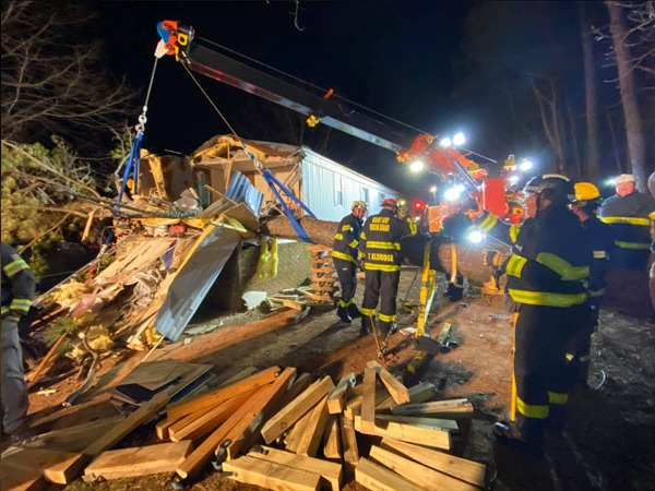 2-year-old girl pinned in her bed when large tree fell on mobile home, rescued by Surry County first responders
