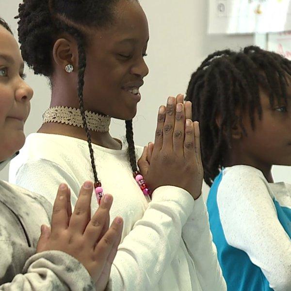 South Graham Elementary School helps kids de-stress with 'Panda Yoga.'
